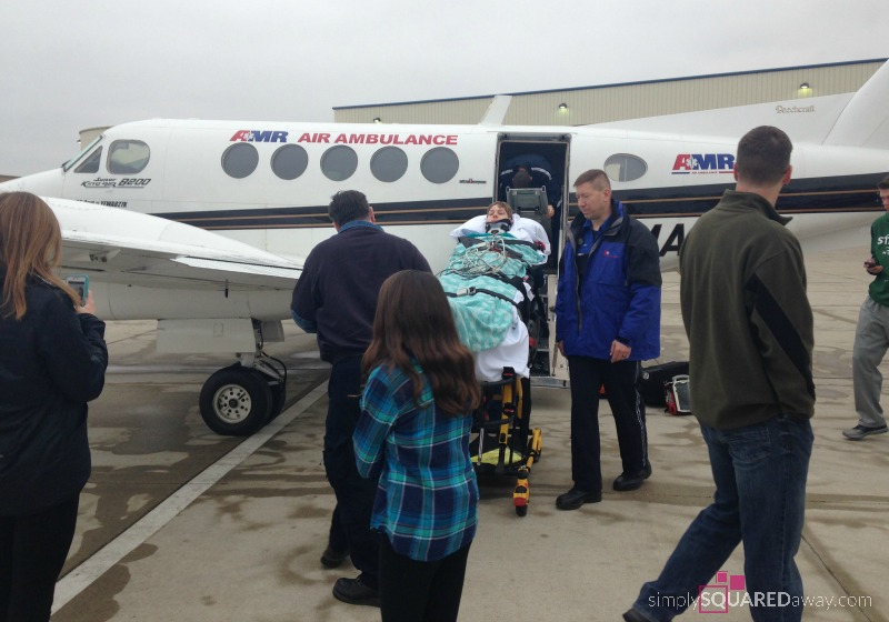 Loading the air ambulance that will transport us to Craig Hospital in Colorado. My Son's Traumatic Accident Part III - a quadriplegic's spinal cord injury rehabilitation. Simply Squared Away Blog